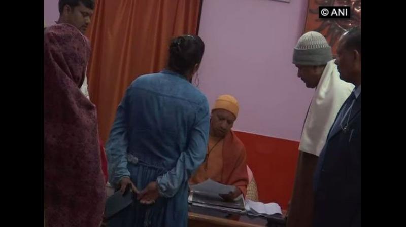 Uttar Pradesh Chief Minister Yogi Adityanath on Monday held a 'Janta Darbar' at the Gorakhnath Temple here to address grievances of people. (Photo: ANI)