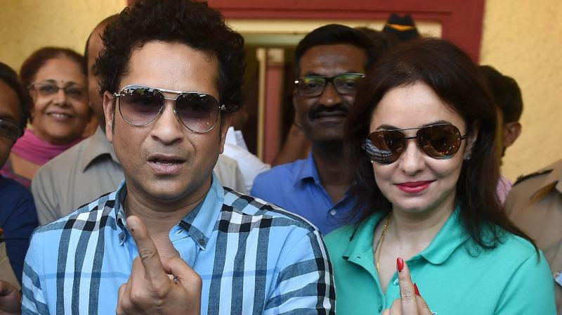 Cricket legend Sachin Tendulkar along with wife Anjali Tendulkar displays the indelible ink mark on their fingers after casting the vote for the municipal corporation election in Mumbai on Tuesday. (Photo: PTI)