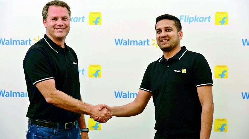 Walmart Inc CEO Doug McMillon with Flipkart Co-Founder and CEO Binny Bansal in Bengaluru during the takeover.