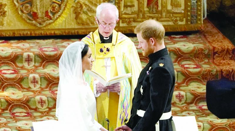 Britain's Prince Harry and Meghan Markle exchange vows during their wedding ceremony at St. George's Chapel at Windsor Castle, near London. (Photo: AP)