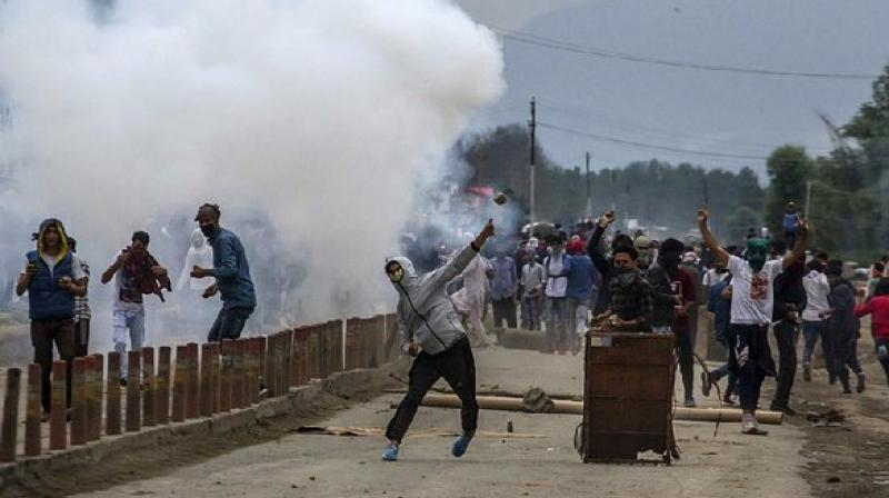 Kashmiri demonstrators throw stones at the police during a protest on the outskirts of Srinagar. (Photo: AP)