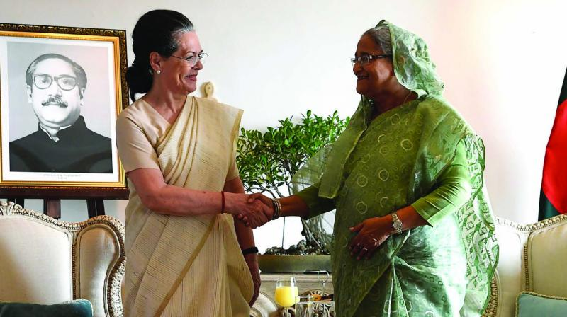 Congress president Sonia Gandhi with Bangladesh Prime Minister Sheikh Hasina on Sunday. (Photo: AFP)