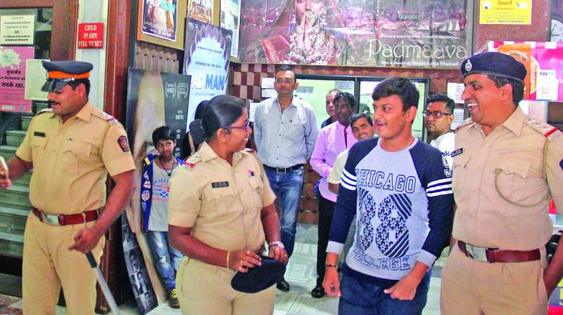 Police personnel at Chitra theatre in Dadar. (Photo :AA)