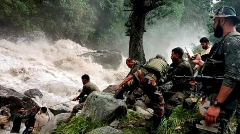Army personnel during a rescue operation after flash floods due to a cloudburst at Hanzor in Kishtwar district. (Photo: PTI)