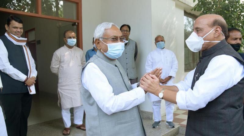 Patna:JD(U) National President Nitish Kumar meeting with Union Defence Minister Rajnath Singh at his officials residence, in Patna on Sunday,Nov.15,2020.( PTI Photo )