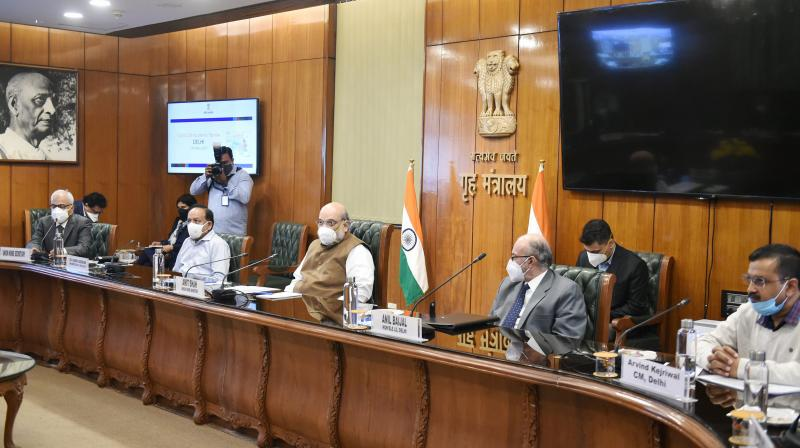Home Minister Amit Shah chairs a meeting over the Covid-19 situation in the national capital with Delhi Chief Minister Arvind Kejriwal, LG Anil Baijal, Union Health Minister Harsh Vardh and Delhi Police commissioner Director of AIIMS Randeep Guleria, in New Delhi, Sunday, Nov. 15, 2020. (PTI Photo)