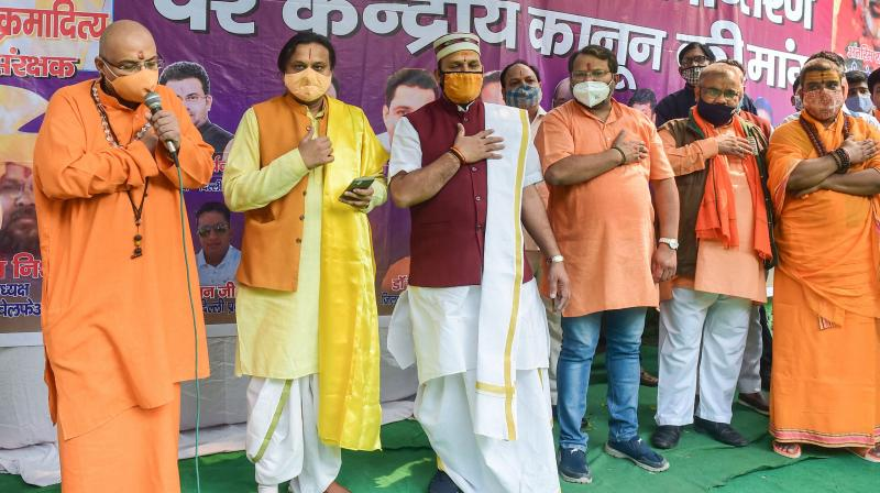Members of Vishwa Hindu Mahasangh take pledge against Love Jihad. Uttar Pradesh Governor Anandiben Patel on Saturday gave assent to an ordinance against forcible or fraudulent religious conversions that provides for imprisonment up to 10 years and a maximum fine of Rs 50,000 under different categories.(PTI)