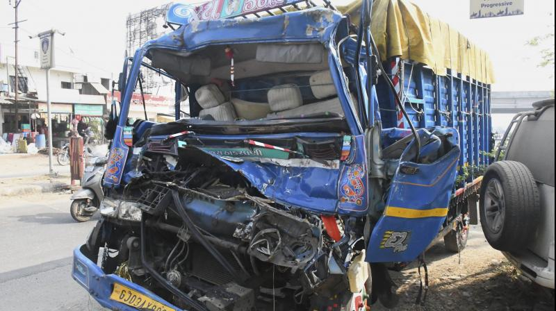 Mangled remains of a mini-truck after it rammed into another truck, on the outskirts of Vadodara, Wednesday, Nov. 18, 2020. At least 10 people were killed and 16 others injured in the mishap. (PTI Photo)