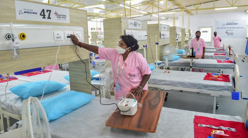Nurses at a 100 bed Covid Care facility inside the campus of Karnataka Power corporation Limited (KPCL), at Yelahanka in Bengaluru. (Photo: PTI)