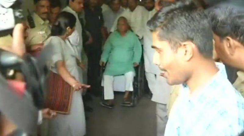 RJD chief Lalu Prasad Yadav, who was undergoing treatment for various ailments related to heart and kidney, was discharged from the All India Institute of Medical Sciences on Monday. (Photo: ANI/Twitter)