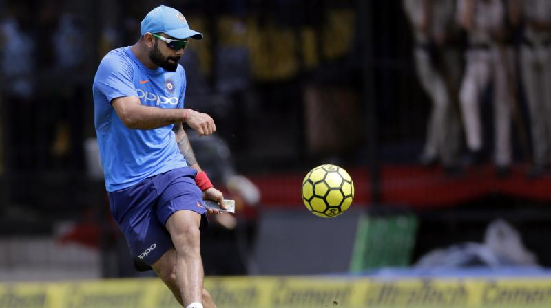 Indian cricket captain Virat Kohli plays football during a practice session in Indore. (Photo: PTI)