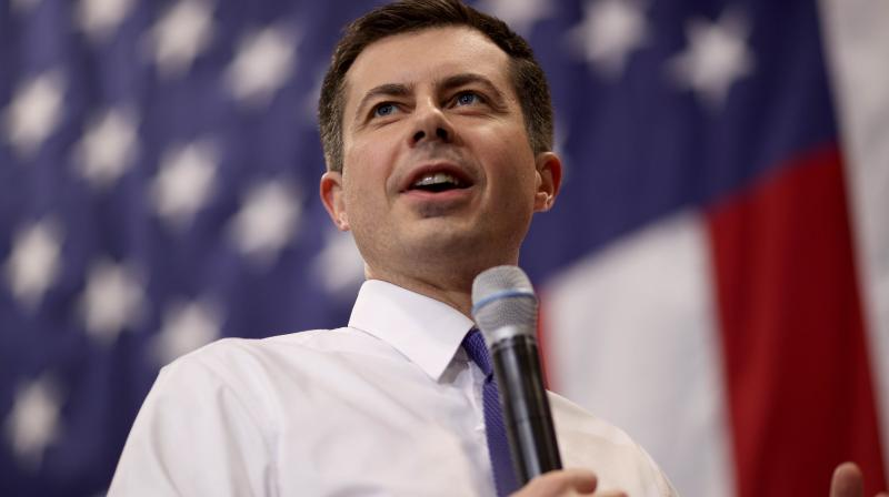Democratic presidential candidate Pete Buttigieg speaks at a town hall campaign event at Salem High School February 09, 2020 in Salem, New Hampshire. New Hampshire holds its first in the nation primary in two days. (AFP)
