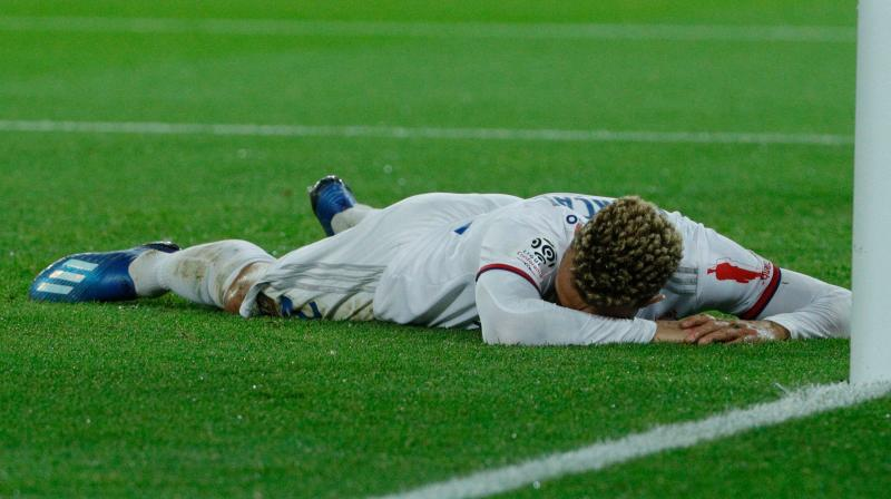 Lyon's Marcal is floored by his own effort. (AFP)
