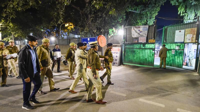 Security personnel at the Atal Adarsh Bengali Girls Senior Secondary School, one of the counting centres for the Delhi Assembly pol. (PTI)ls