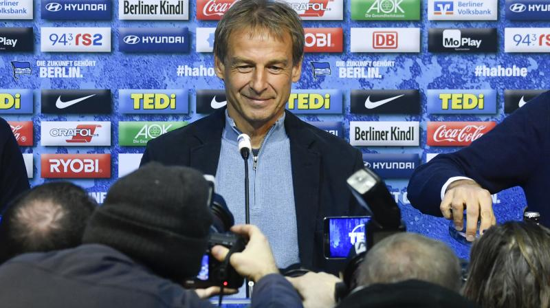 Juergen Klinsmann, former Germany and US head coach, at a press conference in Berlin after German Bundesliga club Hertha Berlin announced he would take over as head coach. (AFP)