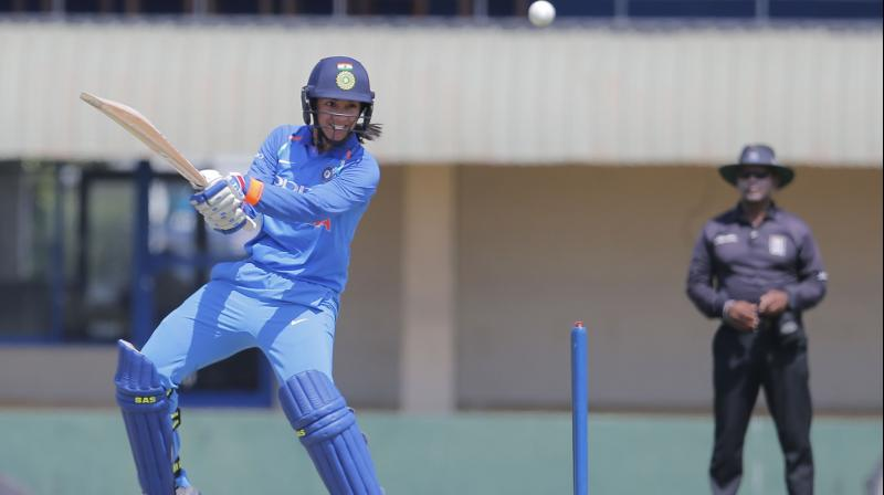 CRICKET BAT OR A SABER: Smriti Mandhana demonstrates her big-hitting prowess during a one-day game for India against Sri Lanka. AP Photo