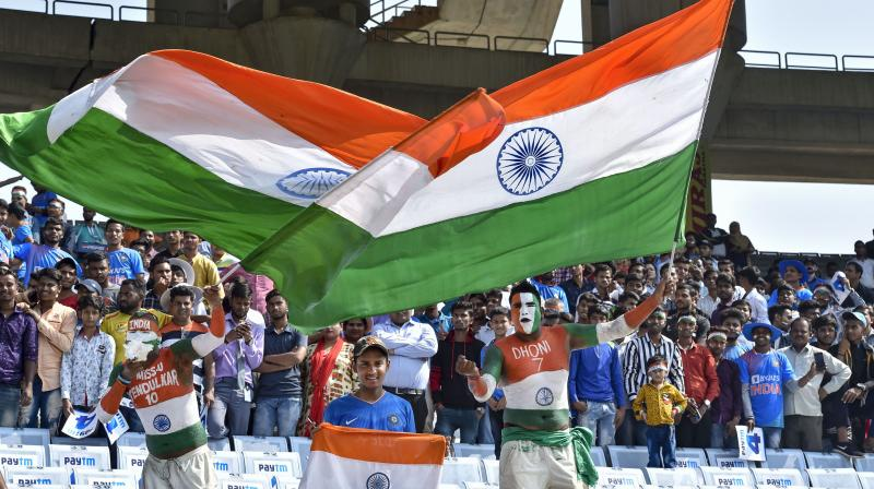 Cricket crazy Indian fans who fill stadiums not just in India but across the world. PTI Photo