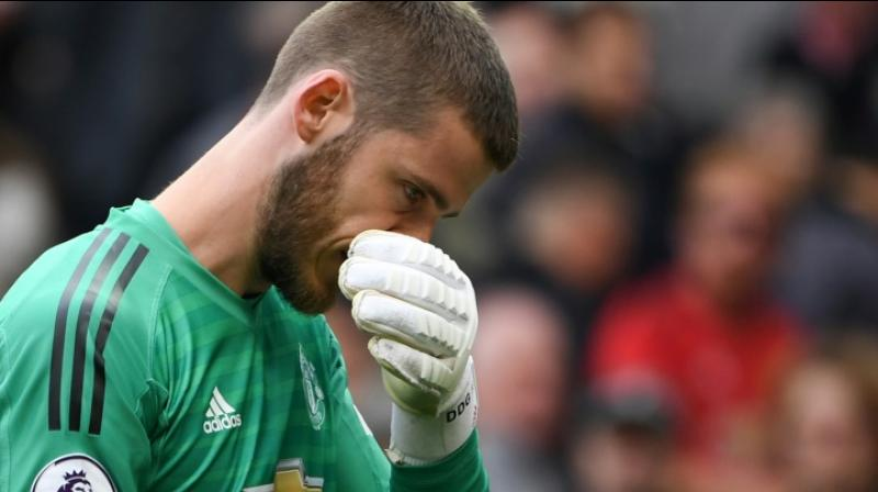 David de Gea has signed a new long-term contract with Manchester United, the Premier League club announced on Monday, ending months of speculation over his future. De Gea has won the Premier League, the FA Cup, the League Cup and the Europa League since arriving at Old Trafford. (Photo:AFP)