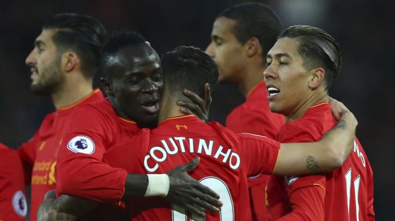 Dutch midfielder Georginio Wijnaldum said Firmino was crucial to Liverpool's way of playing. (Photo: AP)