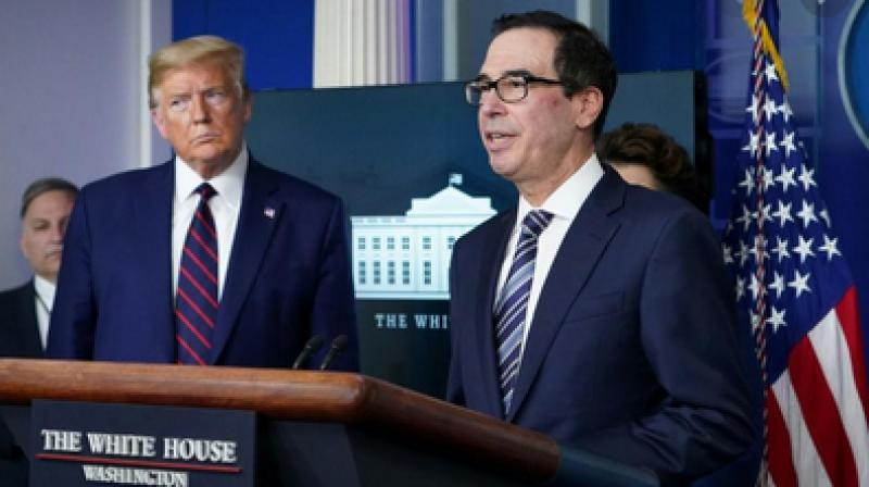 US Treasury Secretary Steven Mnuchin, shown during the White House virus press briefing on April 2, 2020, said the aid will begin but that not everyone would receive a loan immediately (Photo- AFP)