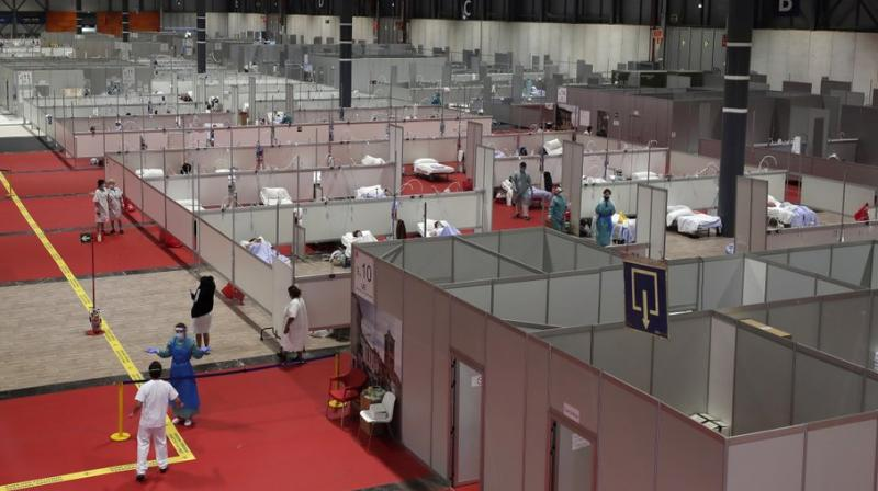A general view a temporary field hospital set at Ifema convention and exhibition of in Madrid, Spain, Thursday, April 2, 2020. The new coronavirus causes mild or moderate symptoms for most people, but for some, especially older adults and people with existing health problems, it can cause more severe illness or death. (AP Photo)