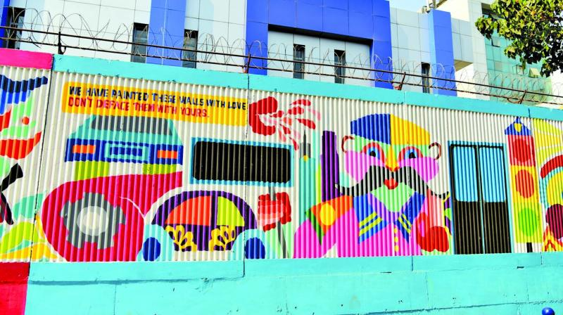 The newly painted wall at the DN Nagar metro station.