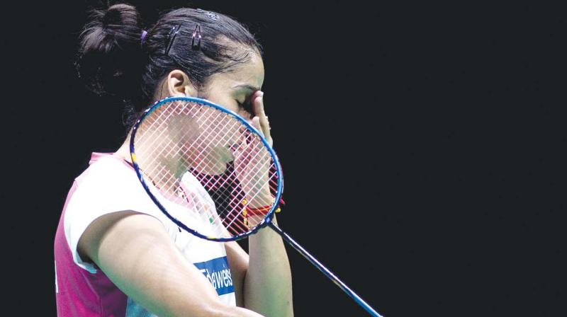 Shuttler Saina Nehwal on Wednesday was knocked out of the ongoing Hong Kong Open after facing a defeat in the first round. (Photo: AFP)