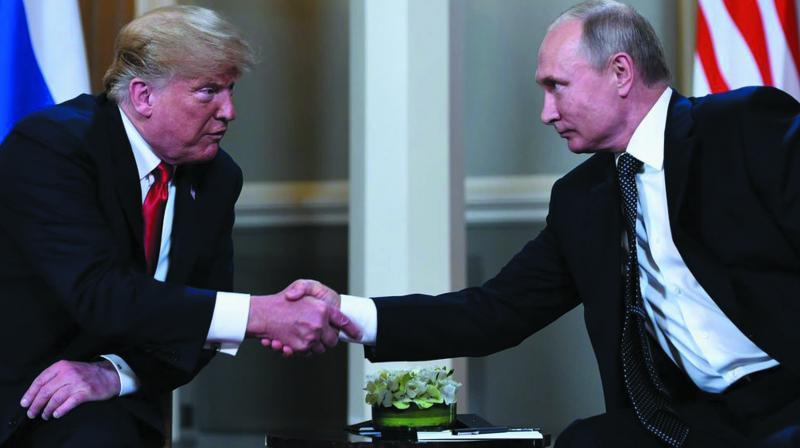 US President Donald Trump with Russian President Vladimir Putin in Helsinki, Finland, on July 16. (Photo: AFP)