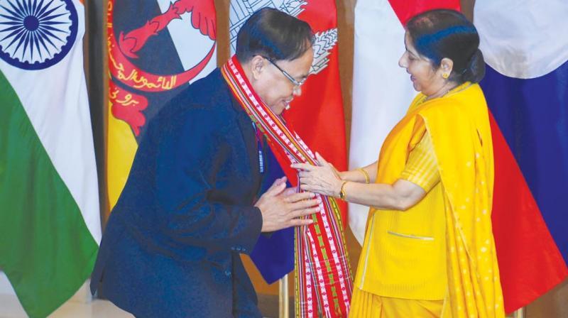 Sushma Swaraj with Myanmar's Union minister U. Kyaw Tint Swe. (Photo: PTI)
