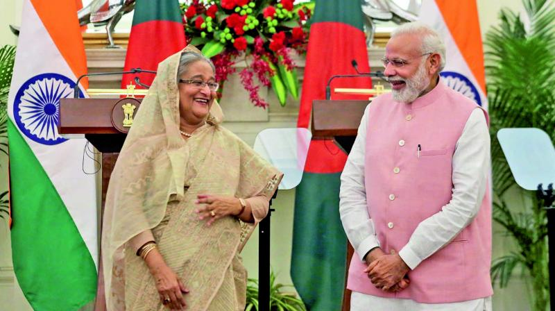 Prime Minister Narendra Modi and Bangladesh PM Sheikh Hasina share a laugh during an agreement-signing ceremony at the Hyderabad House in New Delhi. (Photo: AP)