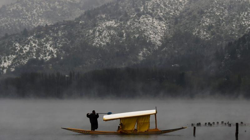 The cold wave resulted in freezing of some water bodies, including the fringes of the famous Dal Lake, and residential water supply pipes. (Photo: File   AP)