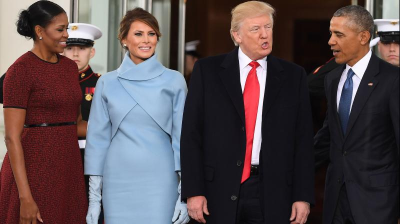 Melania Trump's custom-designed Ralph Lauren outfit, worn with long matching gloves, stiletto shoes, and her long hair swept up in a loose bun, had a 1960s vibe. (Photo: AFP)