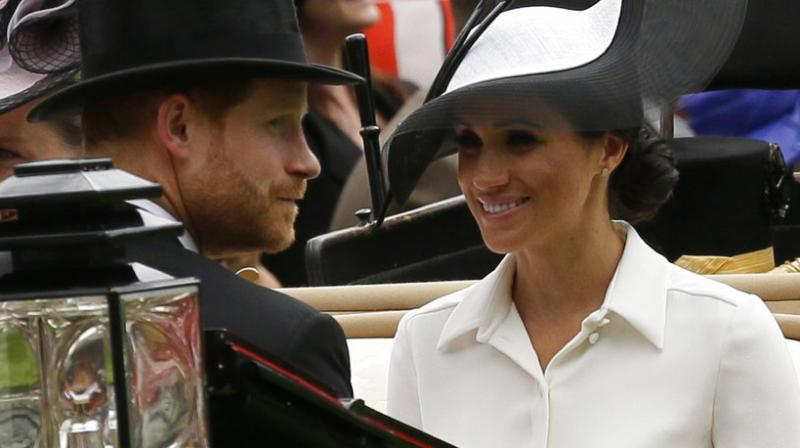 Britain's Prince Harry and Meghan, Duchess of Sussex, arrives at the parade ring with Prince Edward, Earl of Wessex, and Sophie, Countess of Wessex, in a horse drawn carriage on the first day of the Royal Ascot horse race meeting in Ascot. (Photo: AP)