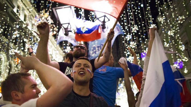 With Moscow being transformed for the World Cup, fans have been overwhelming some of the packed bars and restaurants around the Kremlin and Red Square.  (Photo: AP)