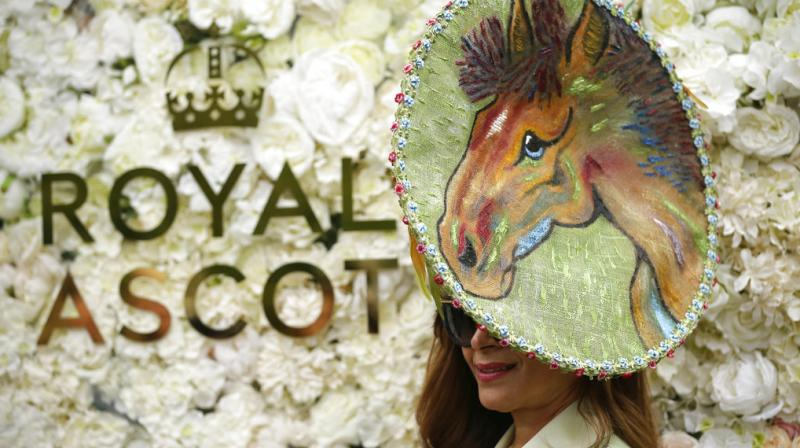 Hats are a compulspory accessory at the posh 5-day racing event in England which sees a flurry of fashion at the event. (Photos: AP)
