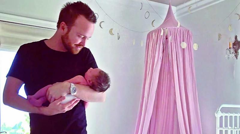 Aaron Paul with his baby daughter Story Annabelle