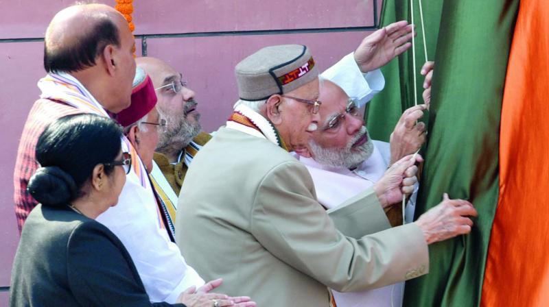 Prime Minister Narendra Modi inaugurates the new BJP headquarters on Deen Dayal Upadhyay Marg in New Delhi on Sunday as BJP president Amit Shah, senior party leaders L.K. Advani, Murli Manohar Joshi, Rajnath Singh, Sushma Swaraj and others look on. (Photo: Asian Age)