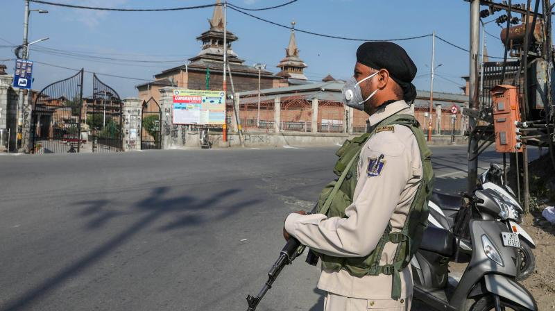 A paramilitary soldier patrols near a checkpoint during a curfew in Srinagar. AFP Photo