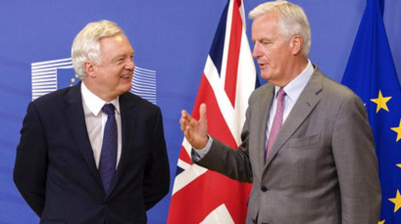 EU Chief Brexit Negotiator Michel Barnier and British Secretary of State for Exiting the EU David Davis attend a media conference at EU headquarters in Brussels on Monday. (Photo: AP)