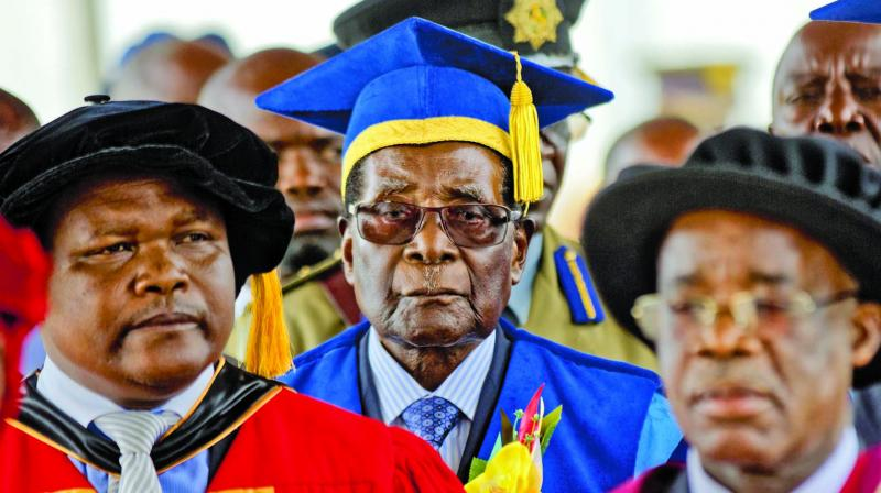 Zimbabwe President Robert Mugabe (centre) arrives to preside over a student  graduation ceremony at Zimbabwe Open University on the outskirts of Harare. (Photo: AP)