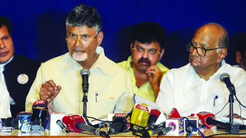 Andhra Pradesh chief minister Chandrababu Naidu speaks as NCP president Sharad Pawar and Congress leader Sushilkumar Shinde look on in Mumbai. (Photo:  PTI)