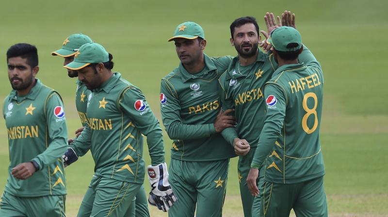 The fine was imposed for Pakistan being one over short of completing their bowling innings within the scheduled period, following which captain Ahmed was docked 20 per cent of his match fee, while the rest of the team docked 10 per cent. (Photo: AP)