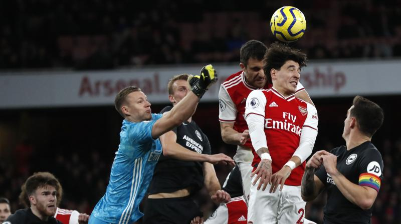 Hector Bellerin struggled to sum up Arsenal's latest setback, a 2-1 Premier League defeat by Brighton & Hove Albion on Thursday, but the defender is confident that if they keep doing what they are doing the results will come. (Photo:AP)