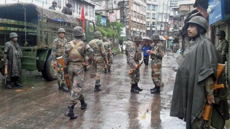 Army deployed in Darjeeling town on Sunday before the funeral procession of two people who died in the police firing on Saturday. (Photo: PTI)