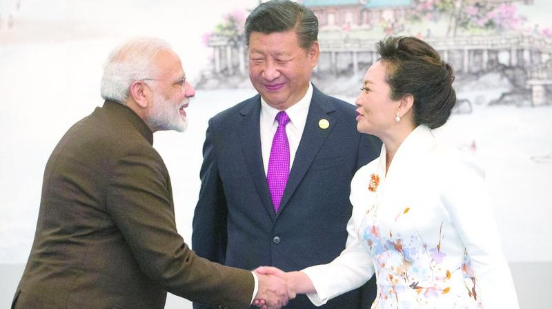 Prime Minister Narendra Modi shakes hands with Chinese First Lady Peng Li Yuan in the presence of Chinese President Xi Jinping during the Brics Summit in China's Fujian province. (Photo: AP)