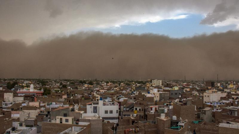 Over 100 people have been injured due to the dust storm, which was followed by thunder showers. (Photo: PTI)