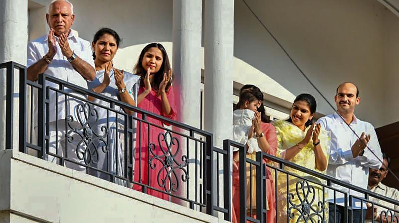 Karnataka chief minister applauds medical personnel fighting the coronavirus on Sunday. (PTI)
