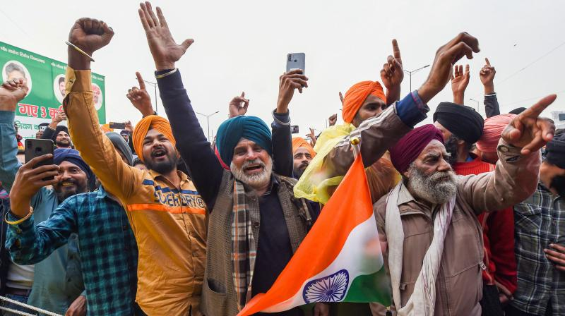 Thousands of farmers from Punjab, Haryana and some other parts of the country have been camping at several Delhi border points since November 28, demanding repeal of the farm laws. (Photo:PTI)