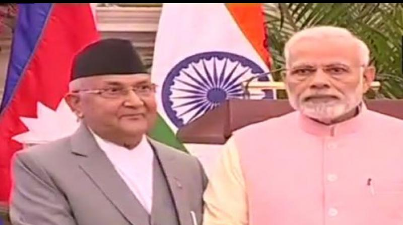 Prime Minister Narendra Modi and Nepal PM KP Sharma Oli. (Photo: ANI | Twitter)