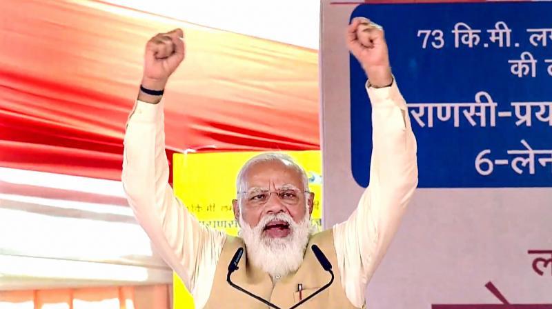 Prime Minister Narendra Modi speaks during the dedication of 6-lane Prayagraj-Varanasi section of NH-19, in Varanasi, Monday, Nov. 30, 2020. (PTI)